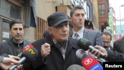 Retired General Cetin Dogan (C) speaks to the media before surrendering himself at a courthouse in Istanbul, February 14, 2011.
