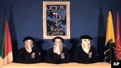 Screen grab taken from Gara website displays an image of ETA armed Basque group members declaring a ceasefire on 5 Sept 2010, in the northern Spanish Basque town of Guernica.