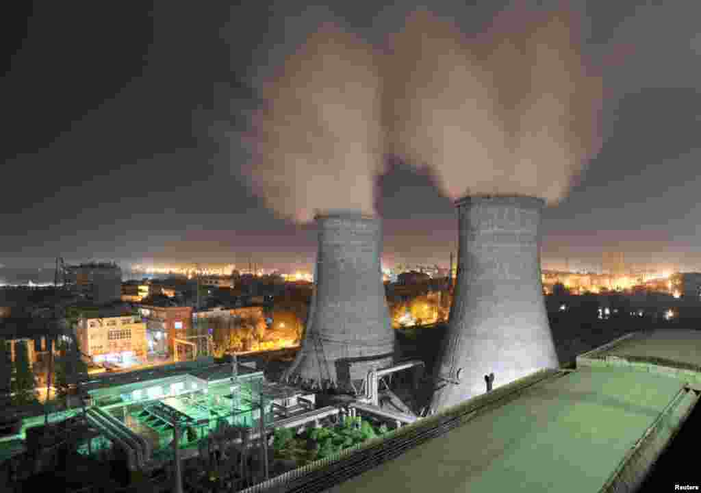 A coal-burning power station at night in Xiangfan, Hubei province, September 15, 2009.