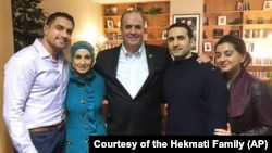 U.S. Rep. Dan Kildee of Michigan meets with former Iran prisoner Amir Hekmati, second from right, at Landstuhl Regional Medical Center in Landstuhl, Germany. Hekmati's family members are with them.