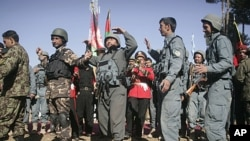 Afghan security forces dance during the second phase of transfer of authority ceremony from the NATO- led troops to Afghan security forces in Qalay-e-Naw, Badghis province, west of Kabul, Afghanistan, January 31, 2012.