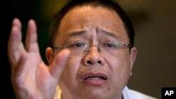 原湖南宁远县工业园区管委会副主任肖疑飞在北京接受采访。(2014年5月5日资料照)