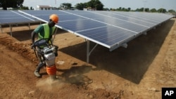 A Ugandan worker builds a solar plant in Soroti about 300 kilometers east of Uganda capital Kampala.