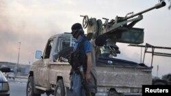 Pobunjenici na kontrolnom punktu na ulazu u Mosul