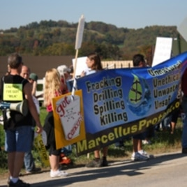 Local Evans City, Pennsylvania residents picket a local dairy that signed a lease with a gas company to fracture a well on its pastures.