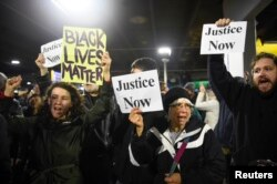 FILE - Black Lives Matter protesters chant slogans at the Mall of America light rail station in Bloomington, Minnesota, Dec. 23, 2015.