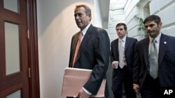 House Speaker John Boehner, who spoke with President Barack Obama Tuesday, arrives for a closed-door meeting with the Republican caucus on Capitol Hill in Washington, Dec. 12, 2012.
