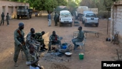 Soldiers rest at the Malian military base in Diabaly, which just 10 weeks ago was under control of Islamist rebels, 400 km from Bamako, March 15, 2013.