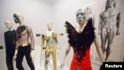 "A variety of stage costumes worn by musician David Bowie are seen at the ""David Bowie is"" Exhibition at the Victoria and Albert Museum in London, March 20, 2013."