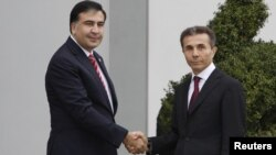 Михаил Саакашвили и Бидзина Иванишвили. Архивное фото 2012г.