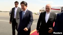 Yaponiya baş naziri Şinzo Abe və İranın xarici işlər naziri Məhəmməd Cavad Zərif