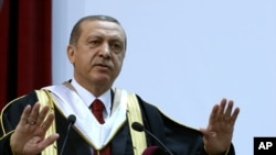 FILE - Turkey's President Recep Tayyip Erdogan addresses an audience after receiving an honorary doctorate from Qatar University, in Doha, Qatar, Dec. 2, 2015.