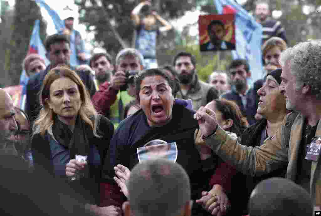 A relative of Serdar Ben, 33, one of the victims of Oct. 10 bombings in Ankara, bursts into tears during his funeral in Istanbul. The twin explosions in the Turkish capital ripped through a crowd of activists rallying for increased democracy and an end to violence between Kurdish rebels and security forces, in the country's deadliest attack in years.