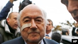 Suspended FIFA President Sepp Blatter arrives for a news conference in Zurich, Switzerland, Monday, Dec. 21, 2015. (AP Photo/Matthias Schrader)