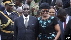 President Robert Mugabe and his wife, Grace.