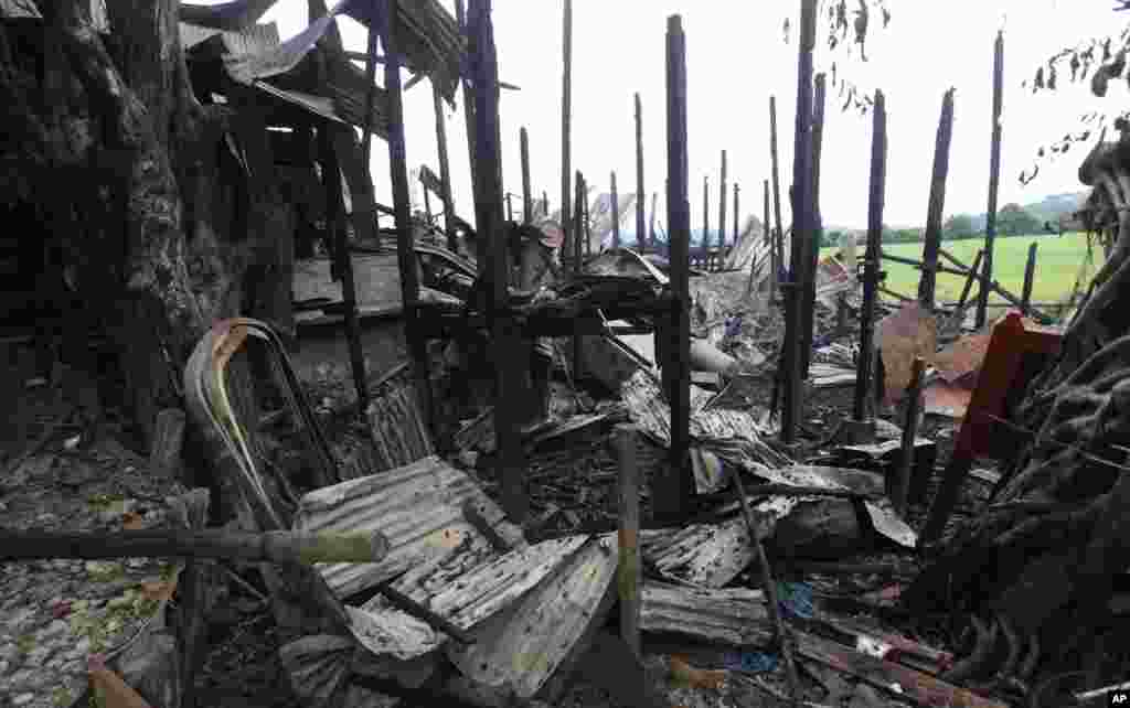 Blackened pillars stand among debris of a burnt building in Thandwe, Rakhine State, western Burma, Oct. 2, 2013.
