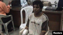 Mohammed Ajmal Kasab, the lone surviving suspected gunman in the 2008 Mumbai attacks, is under police custody at an undisclosed location in this undated photo, February 3, 2009.