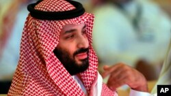 FILE - Saudi Crown Prince, Mohammed bin Salman attends the second day of the Future Investment Initiative conference, in Riyadh, Saudi Arabia, Oct. 24, 2018.
