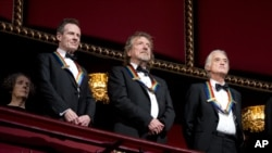 FILE - Rock band Led Zeppelin, from left, keyboardist/bassist John Paul Jones, singer Robert Plant, guitarist Jimmy Page, at the Kennedy Center Honors Gala, Washington, December 2, 2012.