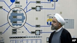 FILE - Iran's President Hassan Rouhani is seen during a visit to the Bushehr nuclear power plant in southern Iran, Jan. 13, 2015.