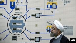 FILE - Iran's President Hassan Rouhani visits the Bushehr nuclear power plant, Jan. 13, 2015. Moscow has removed most of the country's enriched uranium, a Russian envoy said.