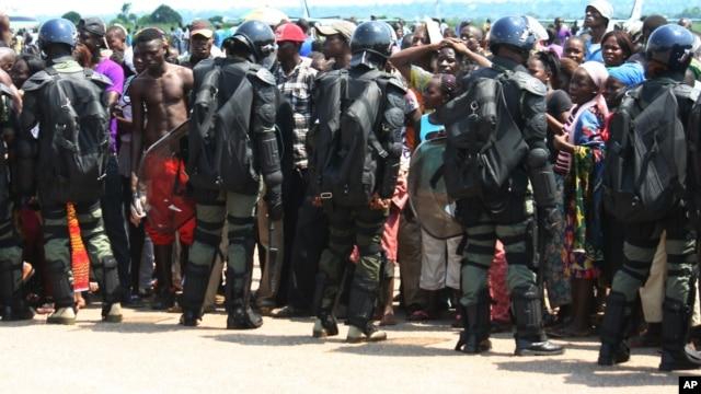 Displaced residents fleeing sectarian violence were cordoned off by military at the airport at Bangui, Central African Republic in late August when the airport was temporarily shut down.