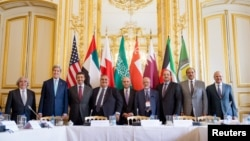 U.S. Secretary of State John Kerry (2nd L) poses for members of the media with foreign ministers of the Gulf Cooperation Council as they meet to discuss Middle East concerns about an emerging nuclear deal with Iran, at the Chief of Mission Residence in Pa