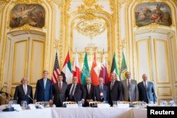 U.S. Secretary of State John Kerry (2nd L) with foreign ministers of the Gulf Cooperation Council as they meet to discuss Middle East concerns at the Chief of Mission Residence in Paris, May 8, 2015.
