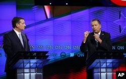FILE - Ohio Gov. John Kasich, right, speaks as Sen. Ted Cruz of Texas listens during the Republican presidential candidates debate sponsored by CNN, Salem Media Group and the Washington Times at the University of Miami in Coral Gables, Fla., March 10, 2016.