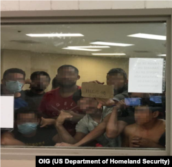 Figure 6. Eighty-eight adult males held in a cell with a maximum capacity of 41, some signaling prolonged detention to OIG Staff, observed by OIG on June 12, 2019, at Border Patrol's Fort Brown Station.