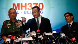 Malaysia's acting Transport Minister Hishammuddin Tun Hussein answers questions between Chief of Armed Forces General Zulkifeli Mohd Zin (L) and Department of Civil Aviation's Director General Azharuddin Abdul Rahmanthe (R) on the missing Malaysia Airline