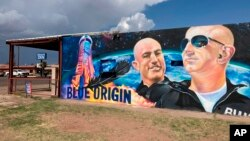 The side of a building in Van Horn, Texas, is adorned with a mural of Blue Origin founder Jeff Bezos on Saturday, July 17, 2021, just days before Bezos launched into space from the Blue Origin spaceport about 25 miles outside of the West Texas town. (AP Photo)