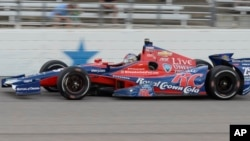 Marco Andretti drives through Turn 4 during the IndyCar auto race, June 8, 2013, in Fort Worth, Texas.