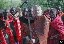 Richard Branson (C), founder of the Virgin Group of Companies, gestures during a ceremony where he was installed as a Maasai elder in the Maasai Mara national Park, 260 km southwest of Nairobi, Kenya, June 2007. (file photo)