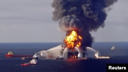 FILE - Fire boat response crews battle the blazing remnants of the offshore oil rig Deepwater Horizon, off Louisiana, in this April 21, 2010.