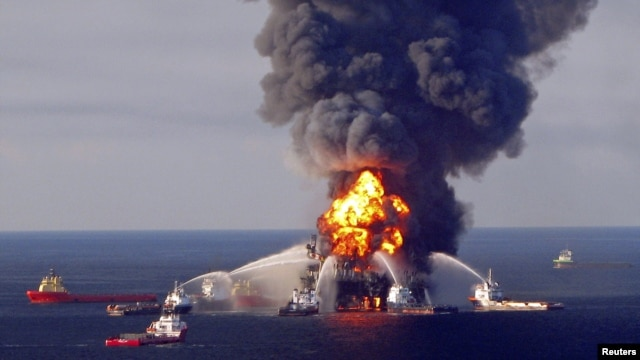 Fire boat response crews battle the blazing remnants of the offshore oil rig Deepwater Horizon, off Louisiana, in this April 21, 2010 handout image.
