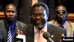 FILE - South Sudan rebel leader Riek Machar addresses news conference in Addis Ababa, Ethiopia, May 12, 2014.