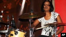 Bianca Nobanda pounds the drums....She's a rarity in modern rock music: a black African woman