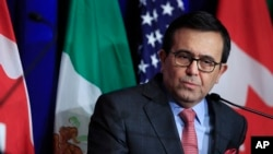 FILE - Mexico's Economy Minister Ildefonso Guajardo Villarreal speaks following negotiations for a new North American Free Trade Agreement (NAFTA), in Washington, Oct. 17, 2017.