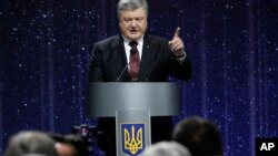 """Ukrainian President Petro Poroshenko speaks at the ceremony commemorating the fallen heroes of the """"Heavenly Hundred"""" in Kyiv, Ukraine, Feb. 16, 2017. The """"Heavenly Hundred"""" is what Ukrainians call those who were killed during the months of anti-government protests in late 2013 and early 2014."""