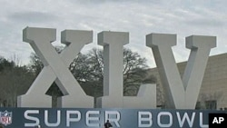 An oversized marquee for Super Bowl XLV outside of Cowboy Stadium in Arlington, Texas, February 2011