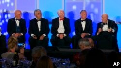 Former Johnson Space Center Director Gerry Griffin, left, a flight director for all of the crewed Apollo missions, sits next to Apollo astronauts Harrison Schmitt, Rusty Schweickart, Walt Cunningham and Tom Stafford, from second from left, during a panel