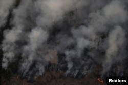 Smoke billows during a fire in an area of the Amazon rainforest near Porto Velho, Rondonia State, Brazil, Brazil August 21, 2019.