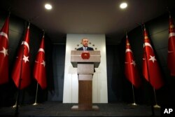 Turkey's President Recep Tayyip Erdogan delivers a statement on national television from his official residence in Istanbul, June 24, 2018.