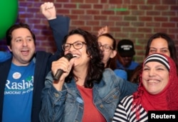 Democratic U.S. congressional candidate Rashida Tlaib celebrates with her mother at her midterm election night party in Detroit, Michigan, Nov. 6, 2018.