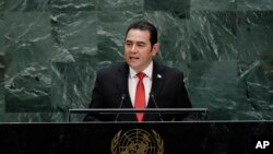 FILE - Then-Guatemalan President Jimmy Morales speaks at the United Nations, Sept. 25, 2019, in New York. Guatemalan journalists interviewed by the Committee to Protect Journalists said conditions deteriorated for them during Morales' time in office.