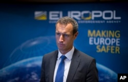 FILE - The head of the European police agency Europol, Rob Wainwright answers questions at The Hague, Netherlands, Jan. 16, 2015.