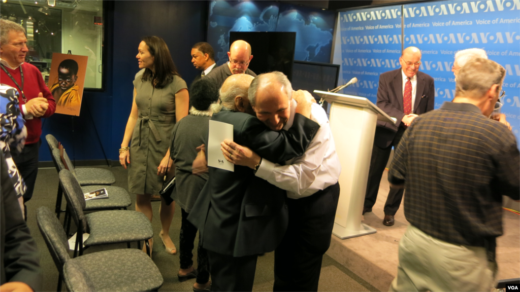 VOA Eurasia Division Director Elez Biberaj embraces Leo Sarkisian.