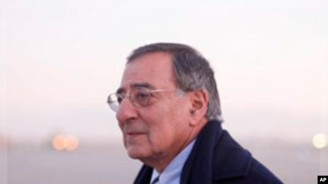 Defense Secretary Leon Panetta walks across the tarmac upon his arrival in Kabul,  Dec., 13, 2011
