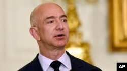 FILE - Jeff Bezos, the founder and CEO of Amazon.com, speaks in the State Dining Room of the White House in Washington.